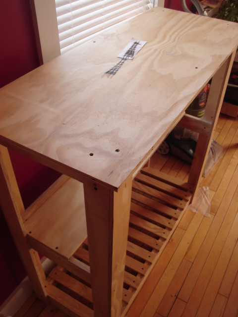 """The layout cart. Plywood construction throughout and the work surface is set at 48"""". The surface area itself is 22x44"""" overall."""