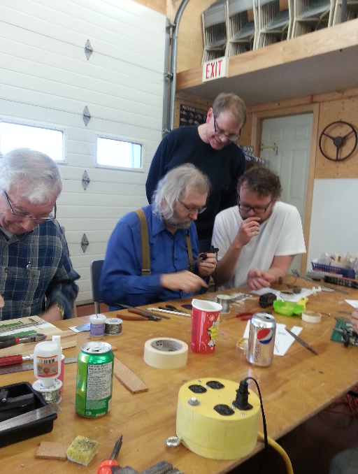 My favourite photo from the entire afternoon. That's my Dad in the blue shirt soldering in a point blade. To the left is Ray and looking on is Scott. That's me looking really thoughtful and maybe even helpful in the white T-shirt. Thanks Taylor for the photograph.