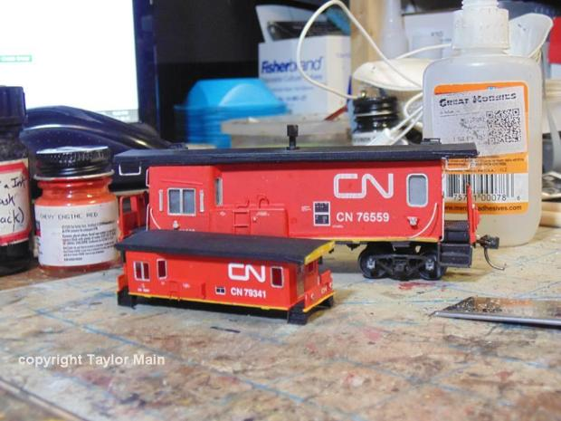 3D printed N scale CN transfer van posed with HO scale for comparison